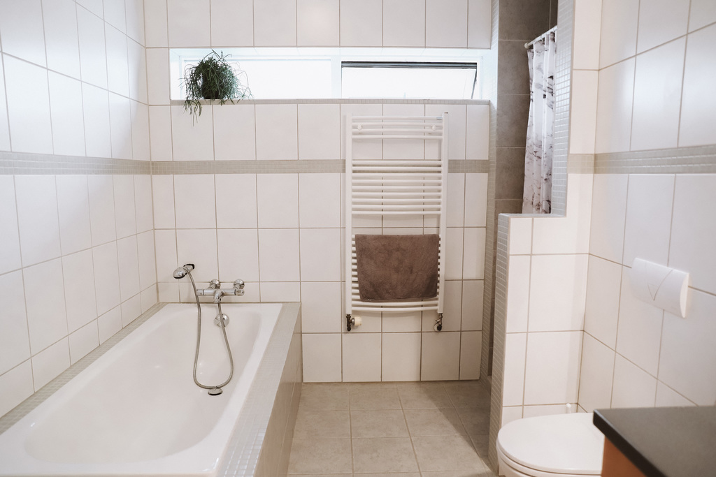 Bathroom with a tub and a shower