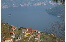Sight on lake Iseo. First yellow house.