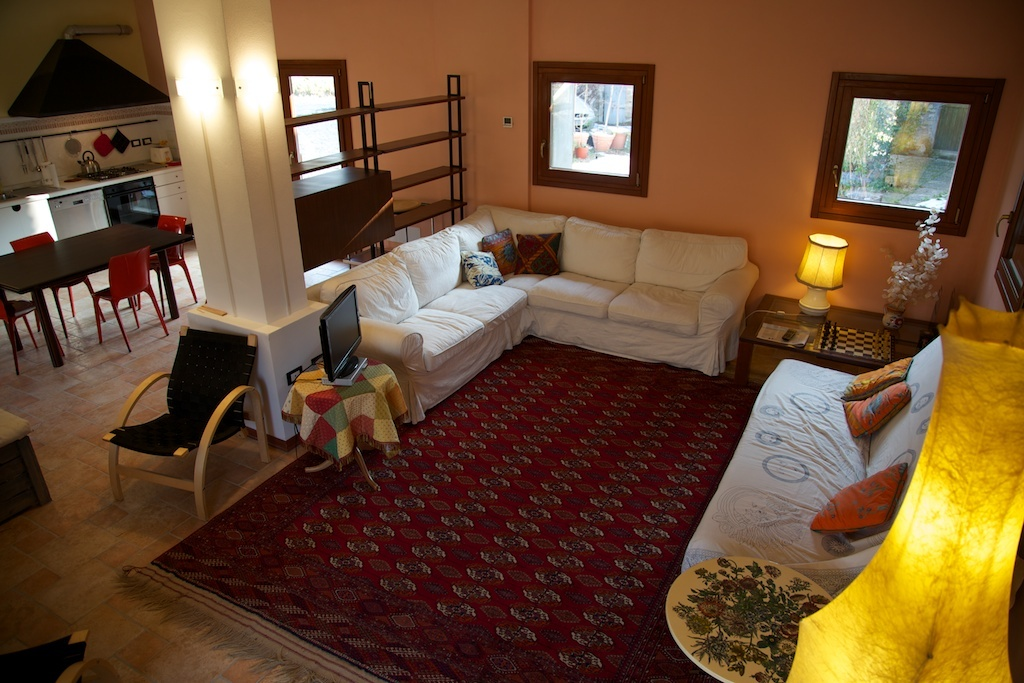 living room downstairs with double bed sofa