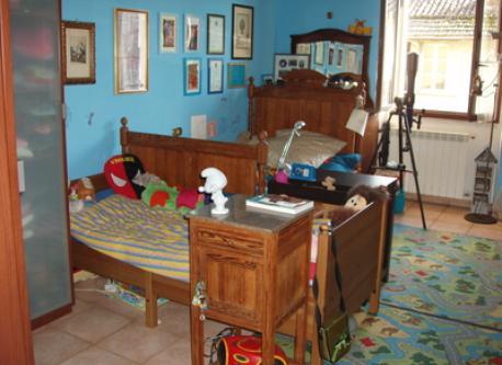 la camera dei maschi con due letti singoli