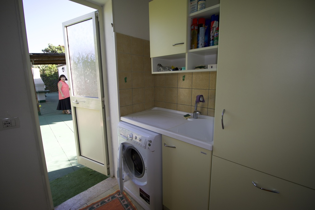 The laundry room is very spacious, furnished with several cupboards for storing beach equipment and toys.