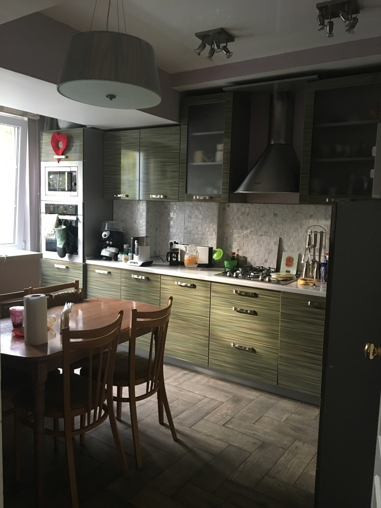 Kitchen with dishwasher, microwave oven, coffeemaker, toster