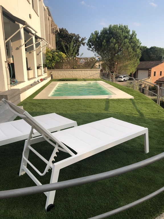 our private swimming pool in our garden with views to Girona city