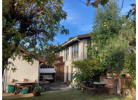The house is in a quiet suburban area with lovely views and a private garden.