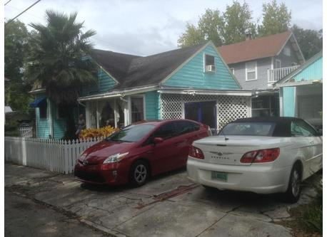 This is the house with 2 of our 3 cars.  Here you see our hybrid Prius (17 kpl) and convertible. We also have a truck.