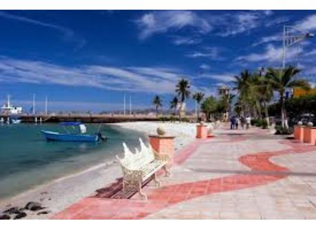 Enjoy a walk and watch the sunset from the malecon, beachside path.