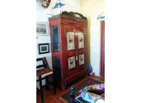 Armoire in Frida Kahlo corner/next to bed and bathroom