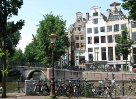 The historical city center with the beautiful canals, canal houses, bridges, trees and house boats