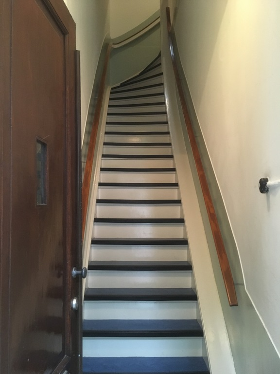 The stairs behind the front door