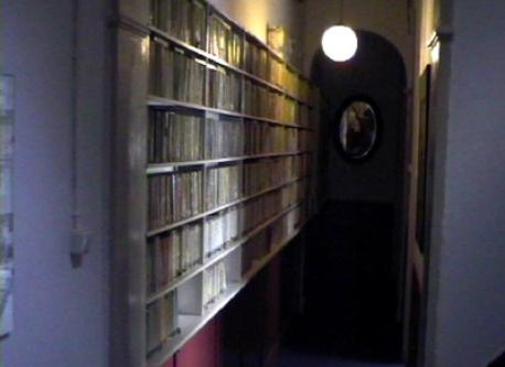 hallway lined with paperbacks