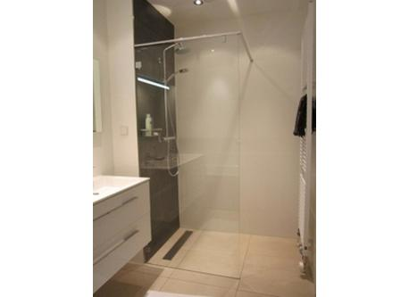 Bathroom with shower, double sink and bath