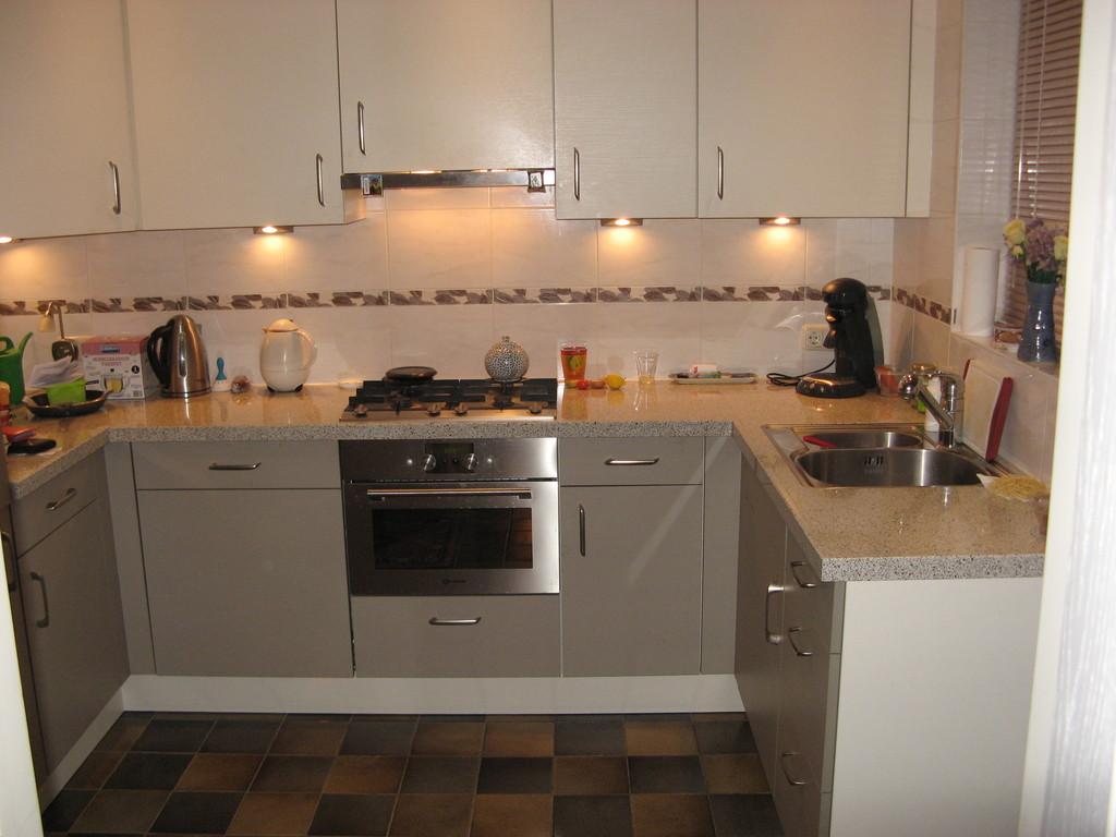 Kitchen with dishwasher, microwave, fridge, freezer (left)