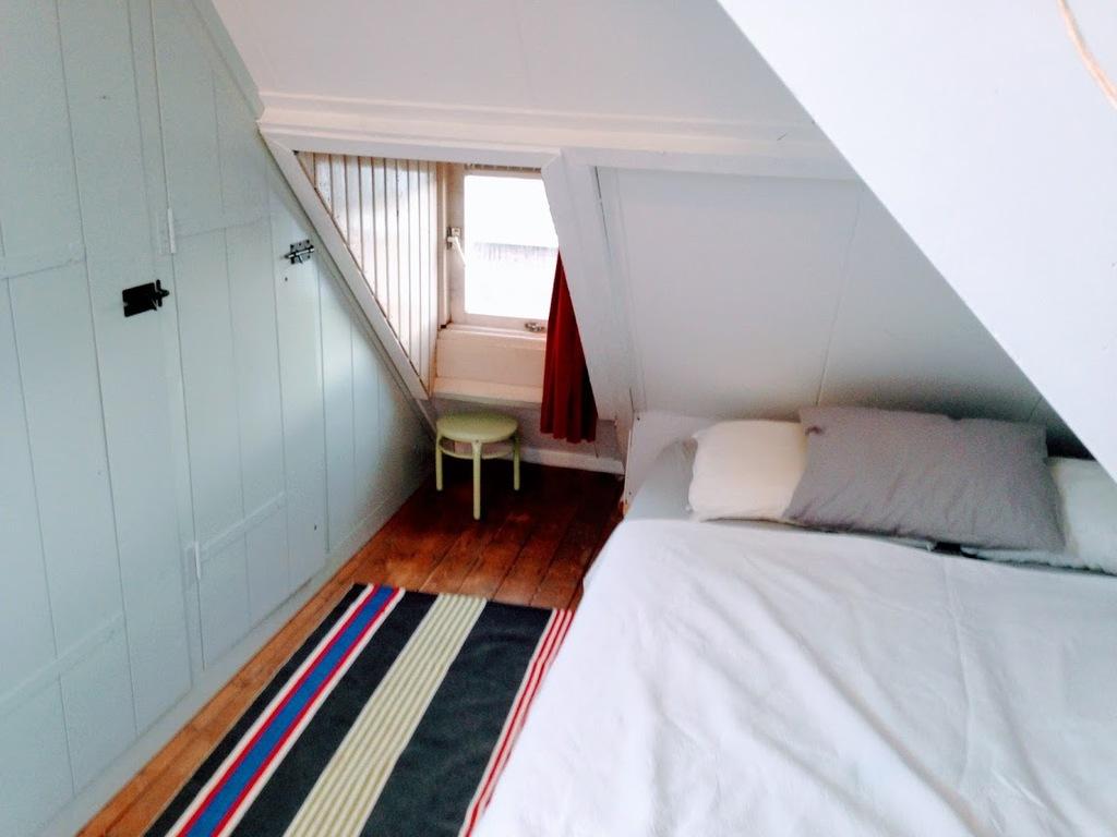 Third floor, 2 single beds in one big space.