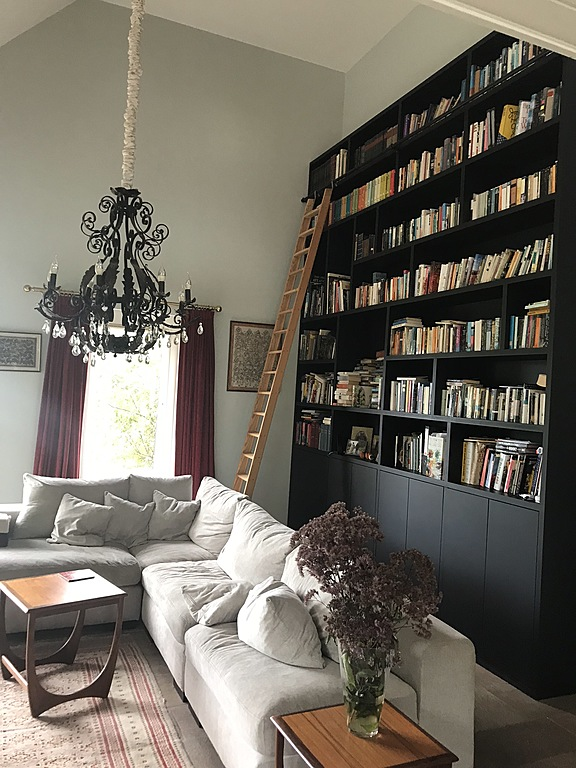 Our livingroom with 5 meter high bookshelve