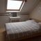 loft bedroom with second digital tv