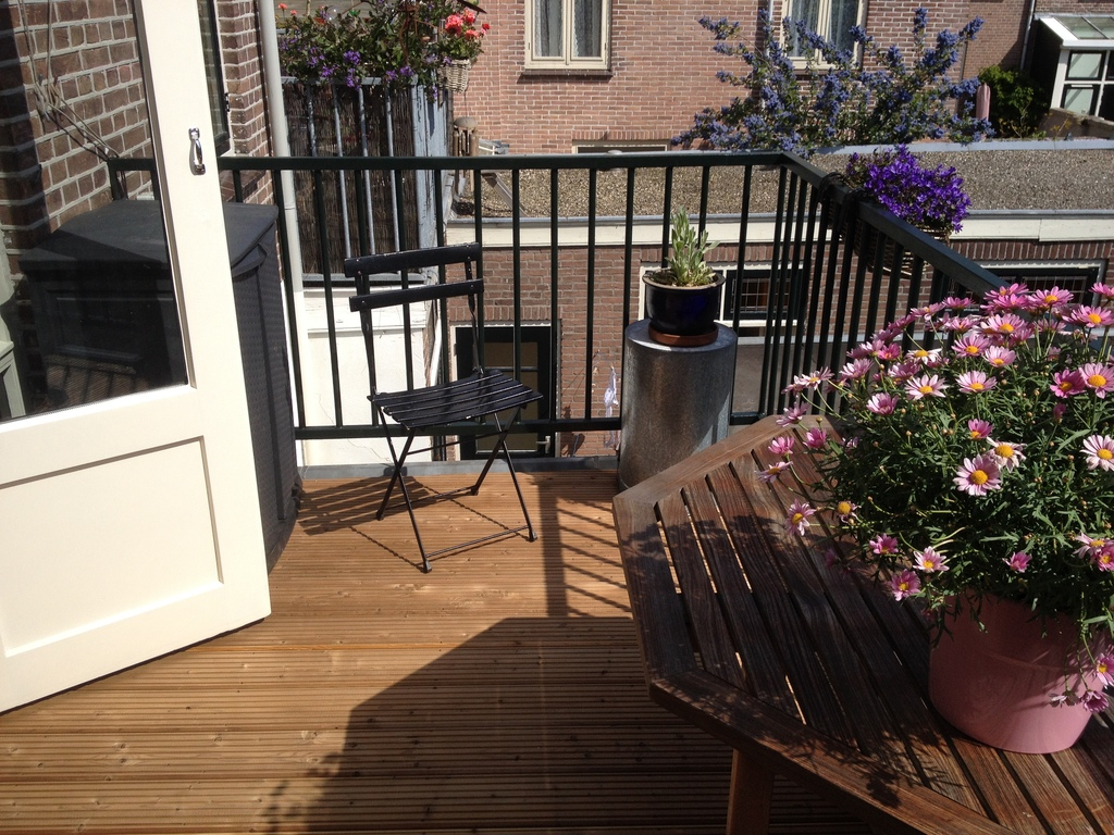 Nice sunny terrace. There is a canopy/porchroof for shadow. Lovely to have breakfast here or a glass of wine in the afternoon.