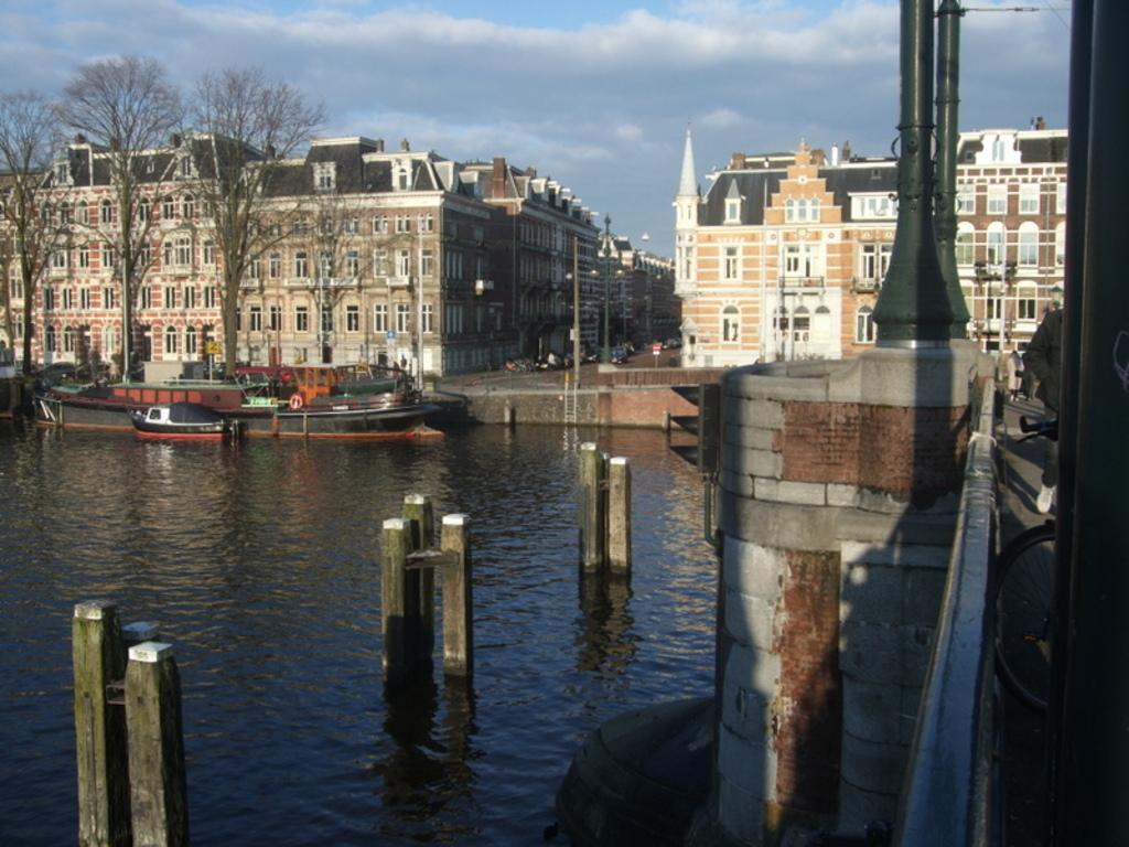on the bridge near the house across the Amstel
