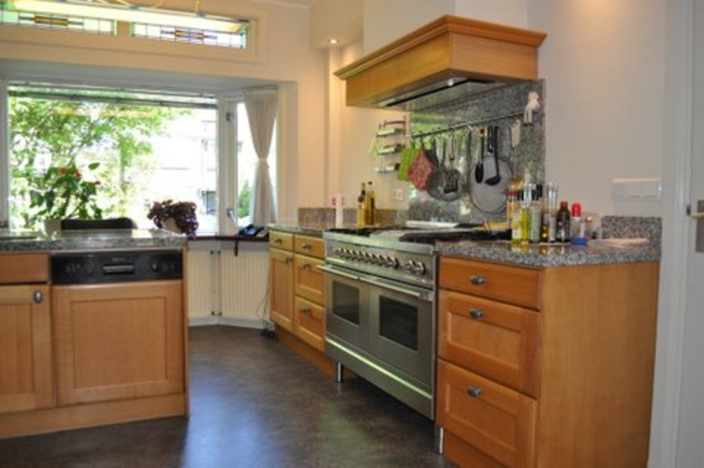 large kitchen with Boretti stove, 2 ovens and bar