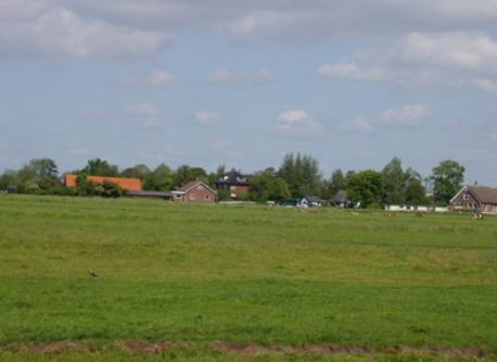 "Vieuw of hte house (with the black roof) from the ""polder"""