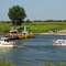 small ferryboat to cross the river maas
