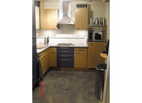 The kitchen with microwave oven and dishwasher.