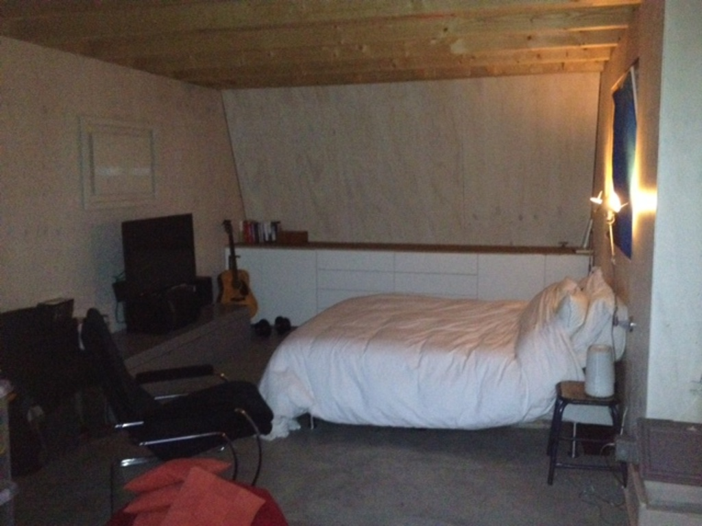 bedroom with double bed next to terrace
