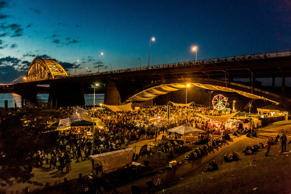 Every summer during a couple of weeks you'll find this small festival with good food and small shows under the Waal bridge.