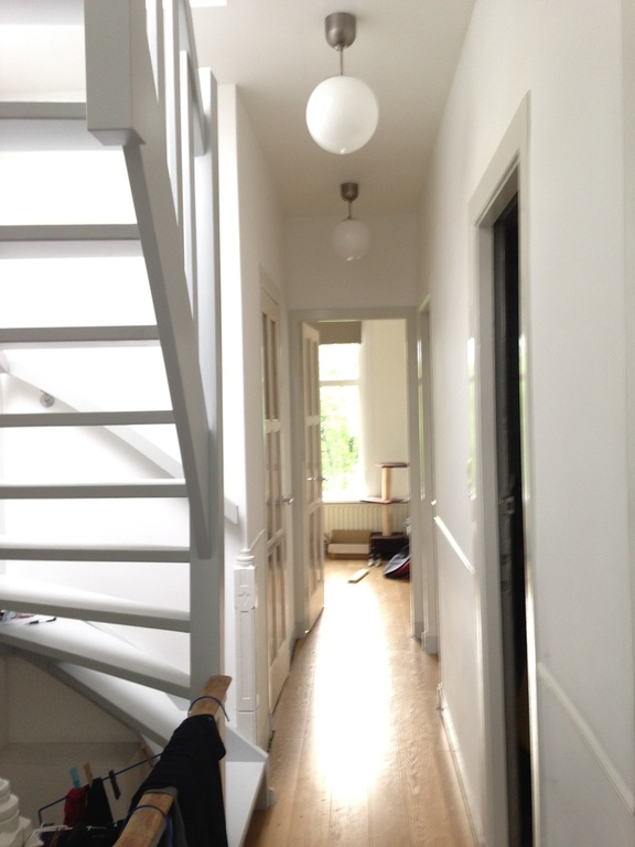 Second floor hallway and stairs to the rooftopgarden