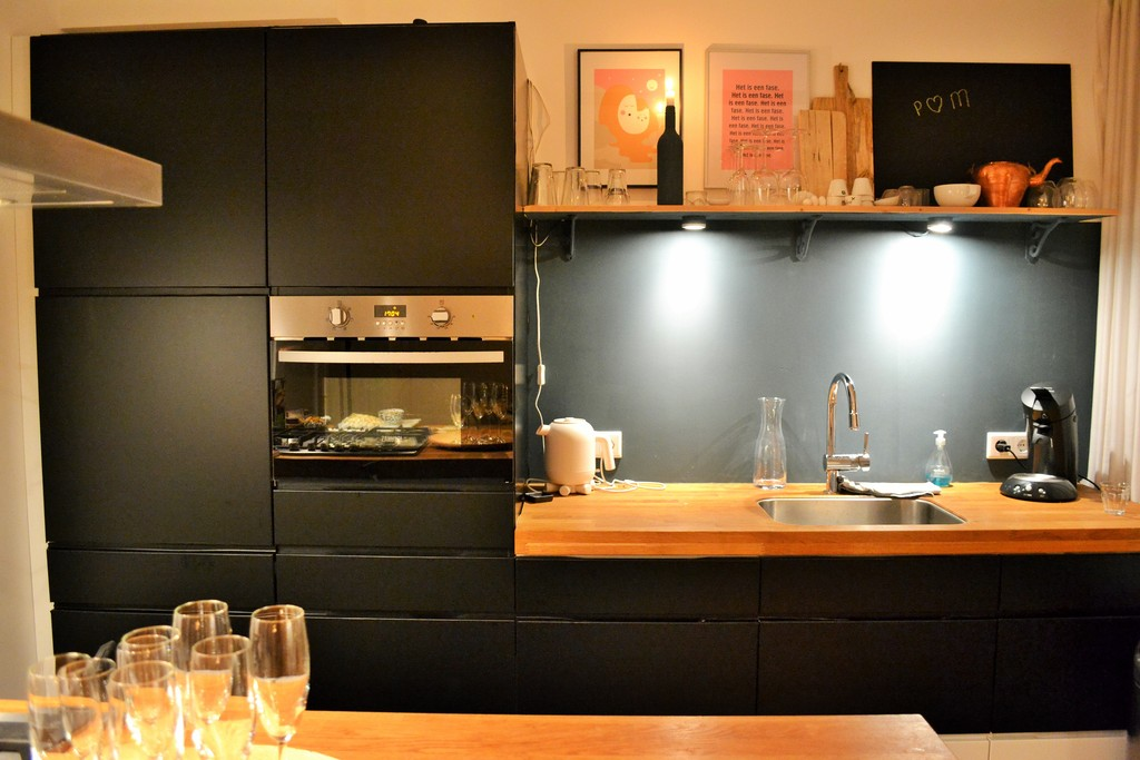 Open Kitchen with microwave/oven combination, dishwasher.