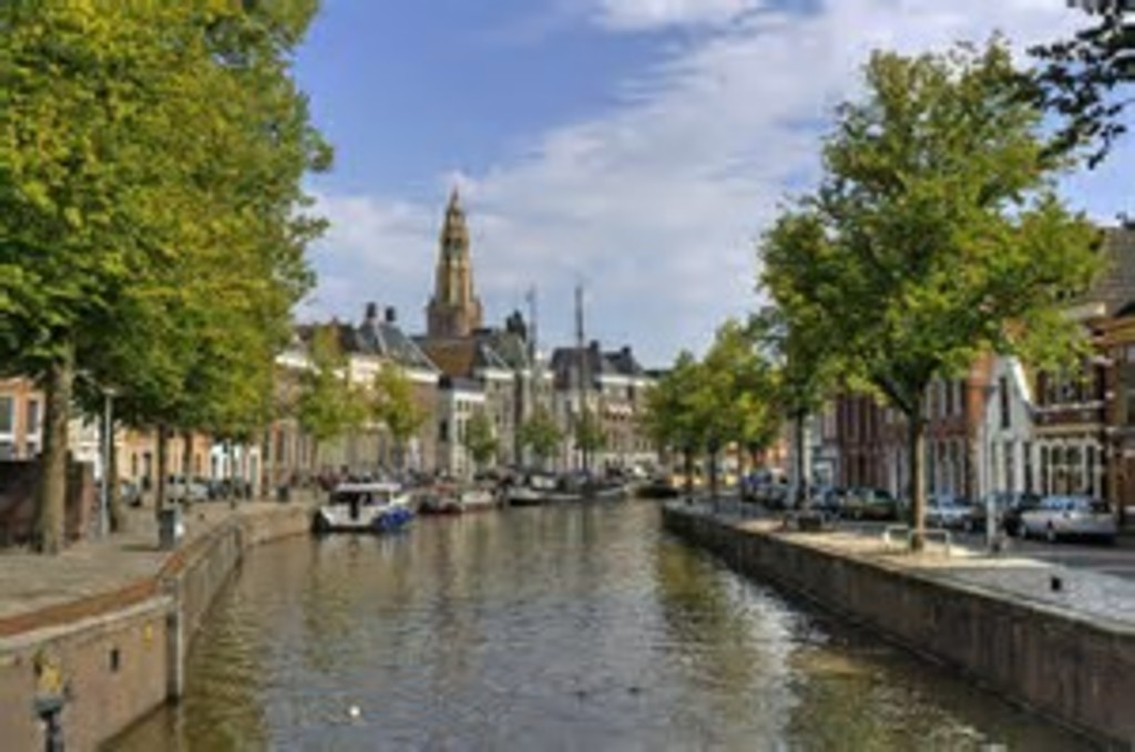 Canal in Groningen. 8 min by car/ bus. 20 min bicycling.