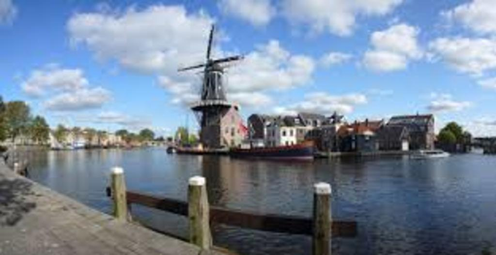 "The river Spaarne which made Haarlem properous with its historic mill the ""Adriaan""."