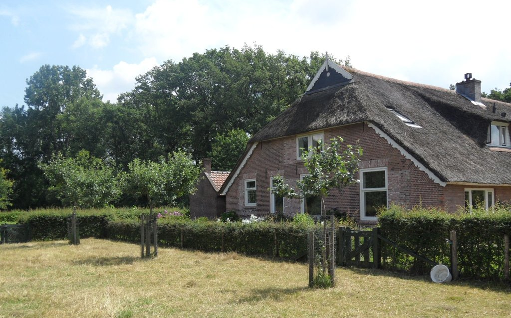 farmhouse with in front the orchard and meadows