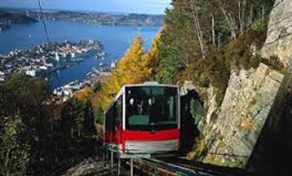 Bergen is surrounded by 7 Mountains. Fløybanen takes you up the nearest.