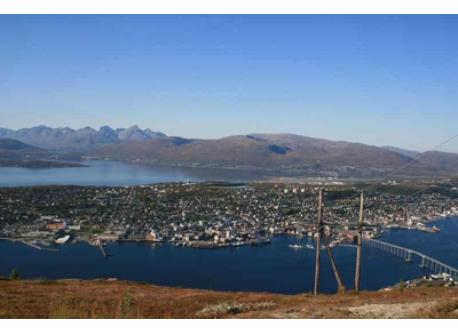 "Tromsø as seen from the mountains. This view is easily accessible by means of ""Fjellheisen"" (Cable car ride)."
