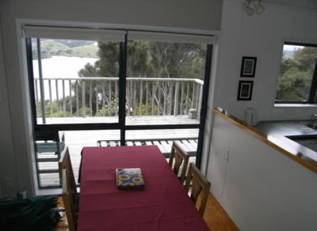 Double doors to the deck open off the dining area.