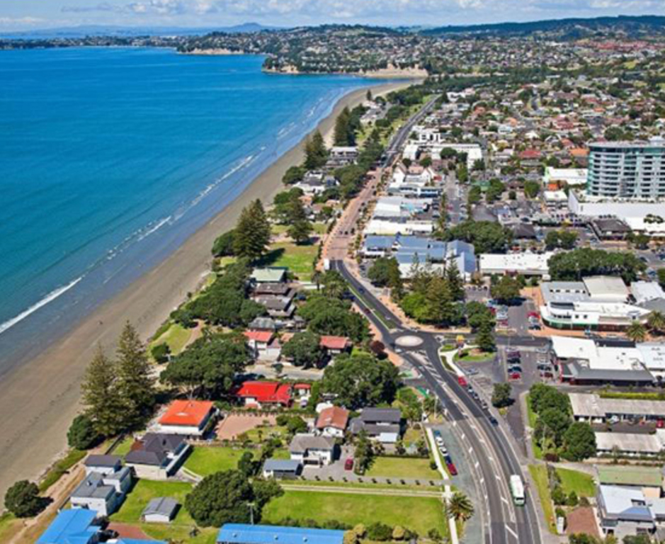 Aerial view of Orewa beach and town, looking down from our end of the beach.