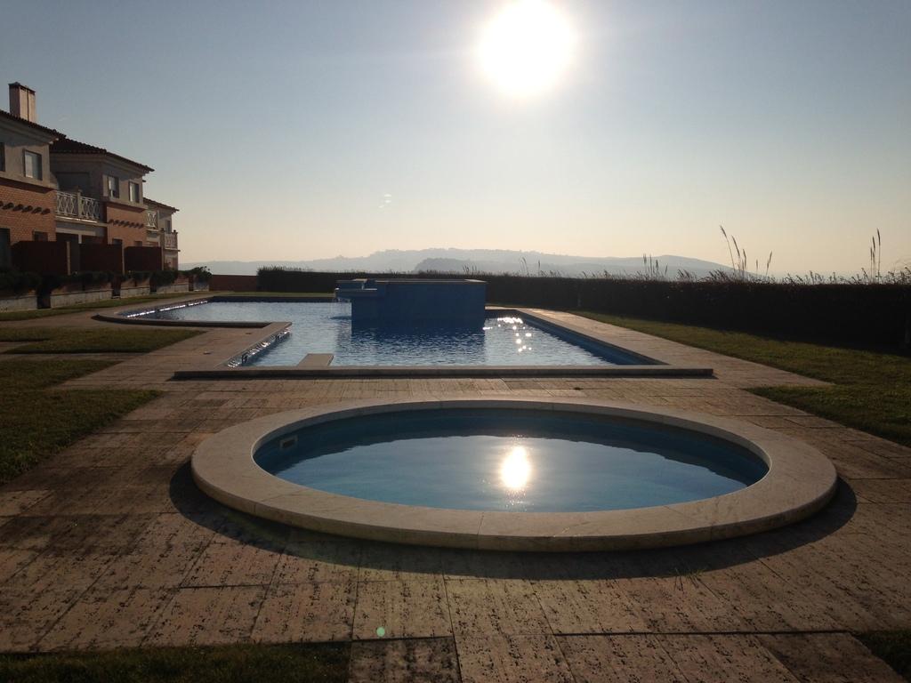 The swimming pool of the condominium.