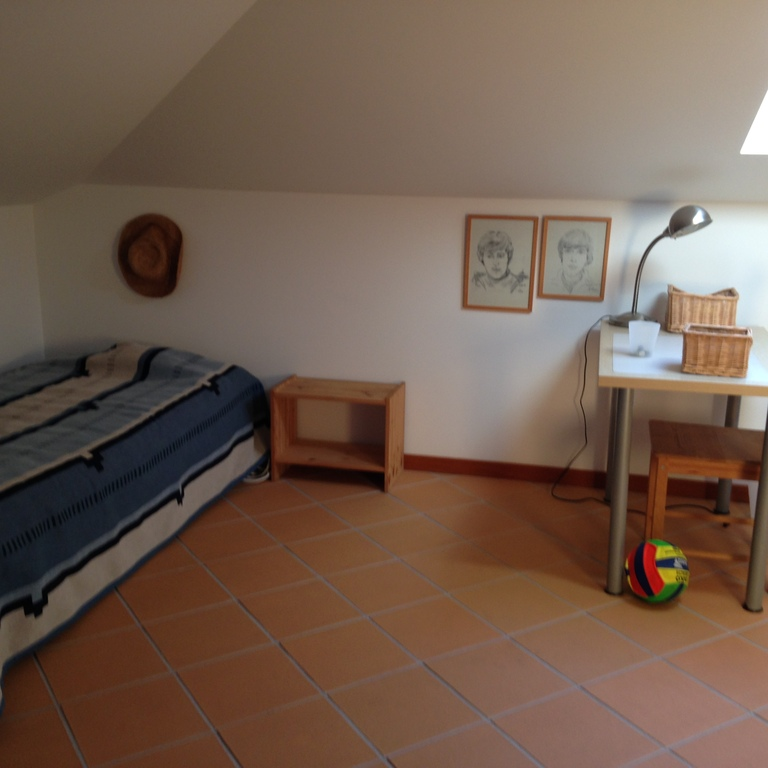 One room with three single beds, upstairs in the loft.