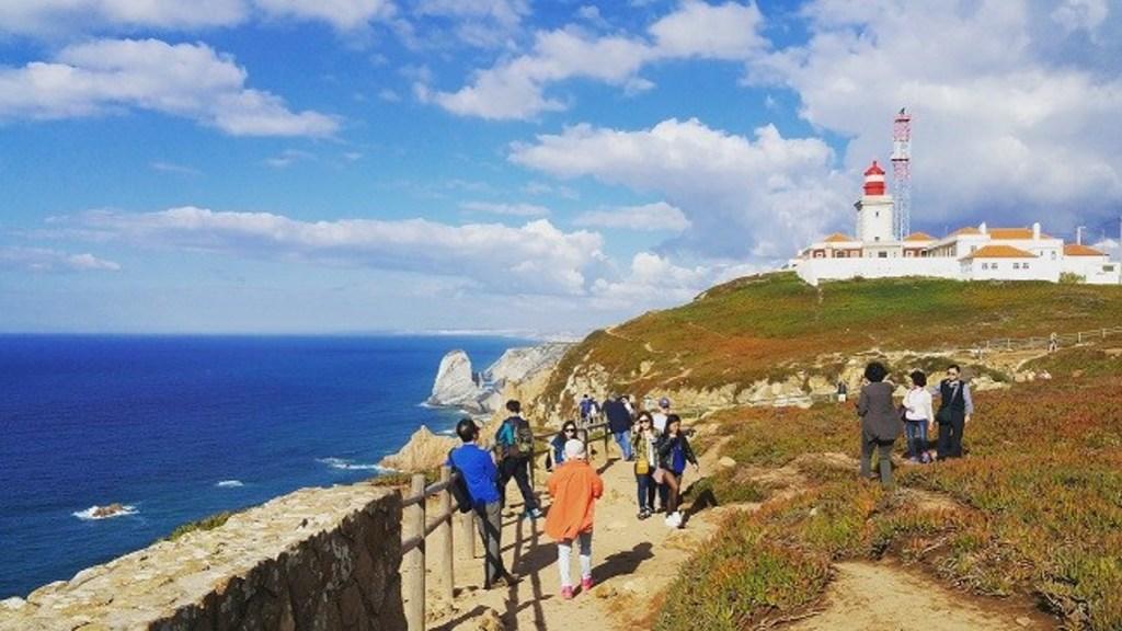 "Cabo da Roca, landmark cross inscription ""Land ends and the sea begins"" Portuguese poet Luis Camões."