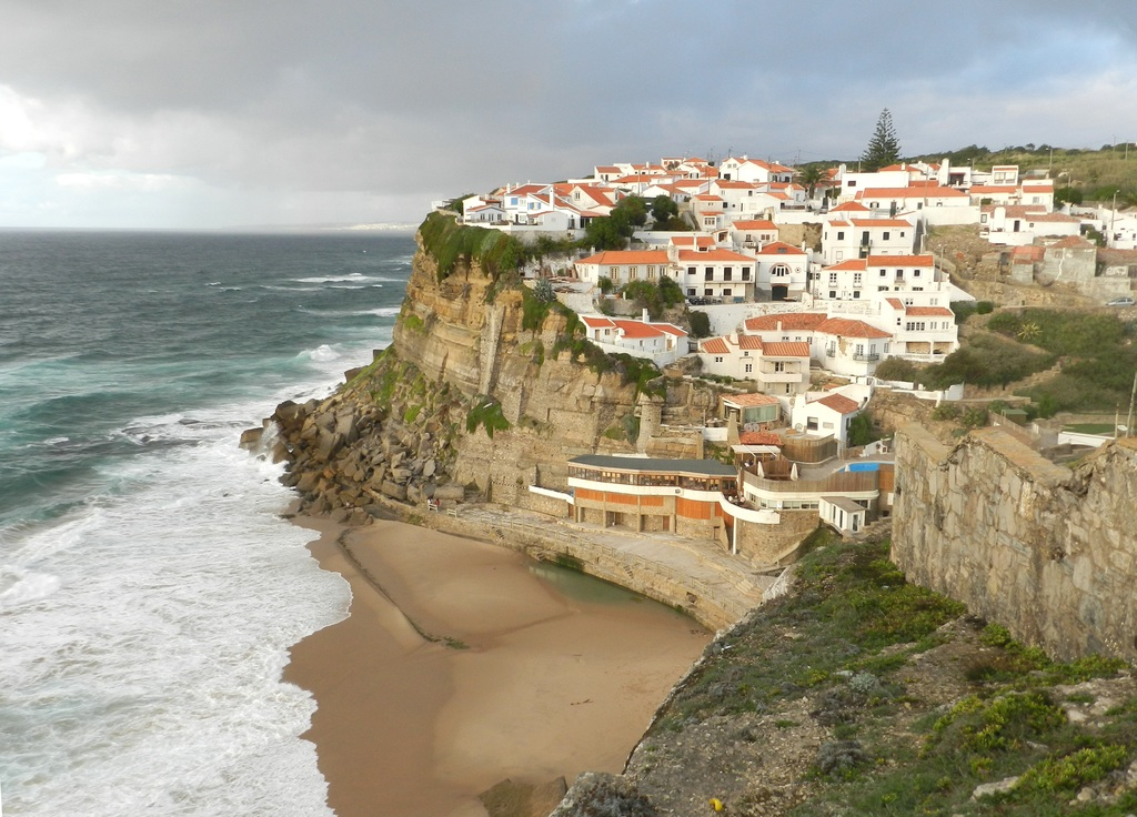 Azenhas do Mar is a small coastal town to take a break on a small sandy beach with a seawater pool.