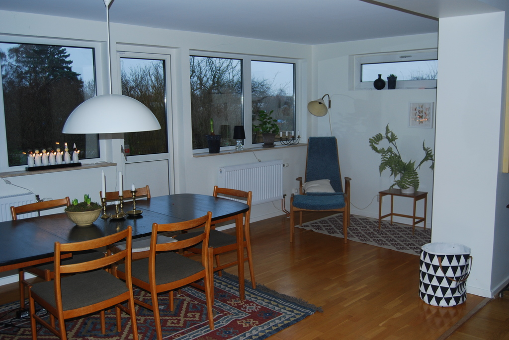 One part of the living room with access to the patio and garden