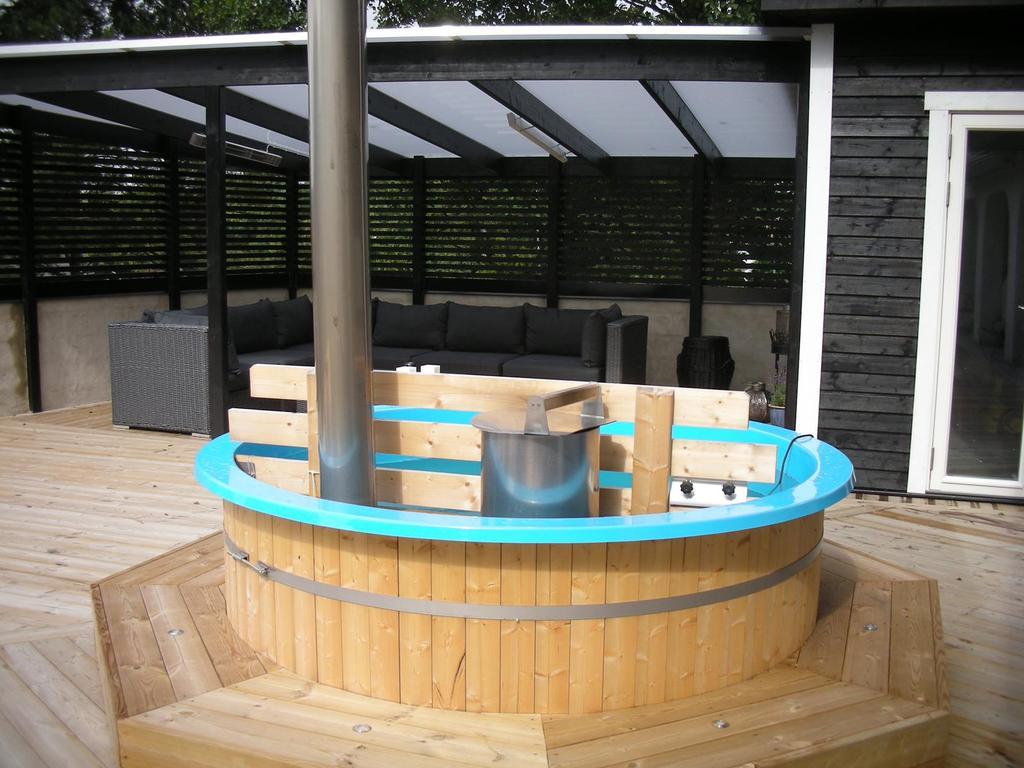 The firewood heated bath tub