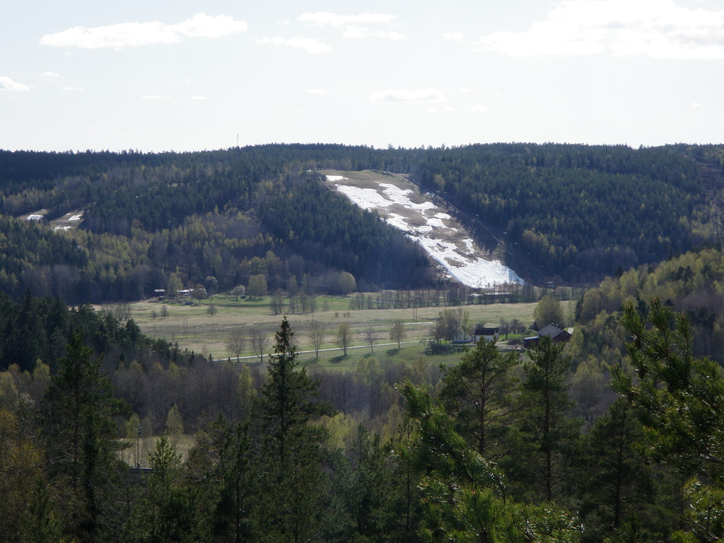 alpine ski center in the spring from cliff close to apartment
