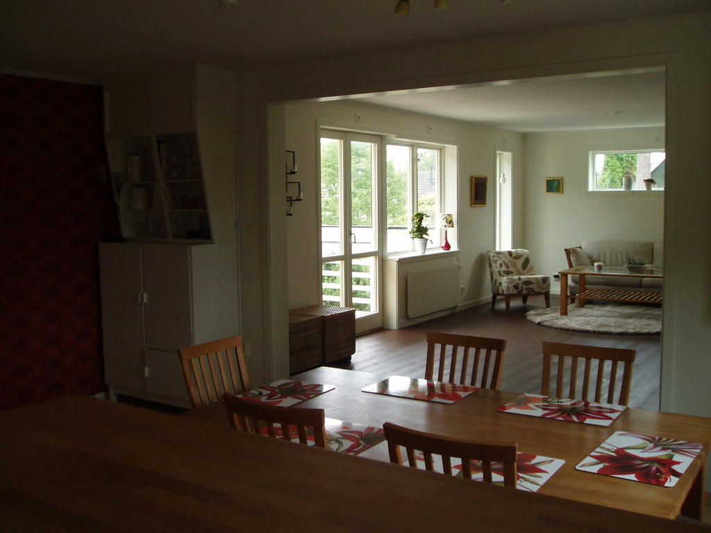 View from kitchen into diningroom and upper TV room