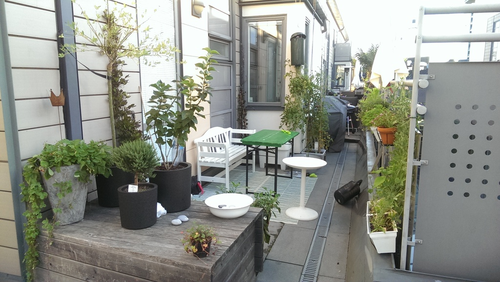 A nice little patio with a grill where neighboors walk by and say hello.