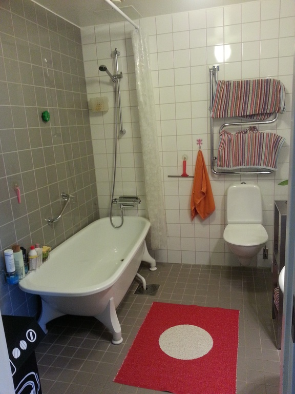 Upper level bath room with shower and tub