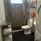 Lower level bath room with shower, washing machine and tumble dryer