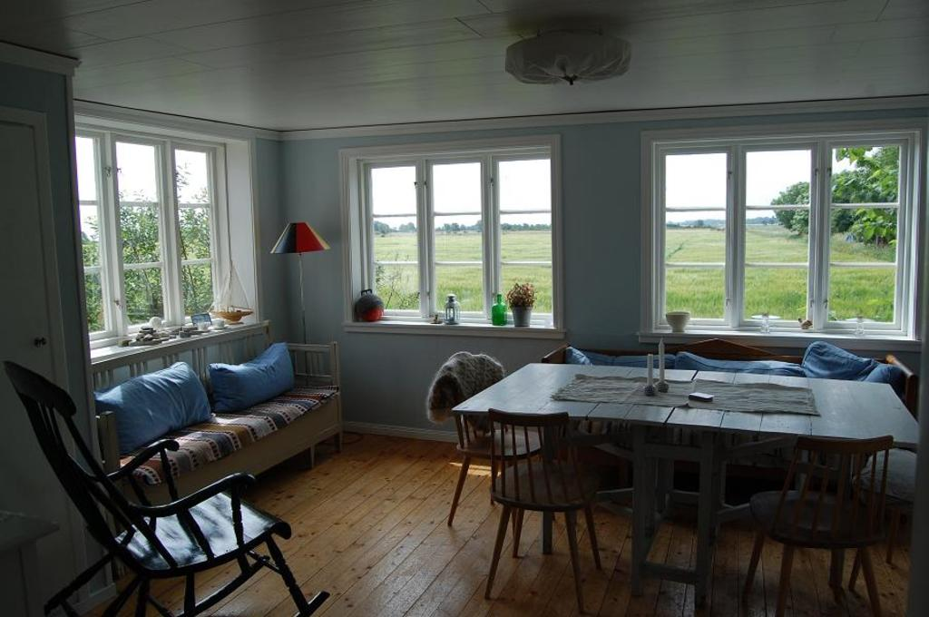 Öland. The sitting-room with a view over fields and the Baltic Sea.