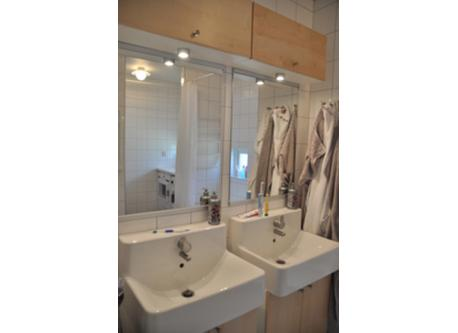 Downstairs bathroom with a bathtub and washing machine and dryer