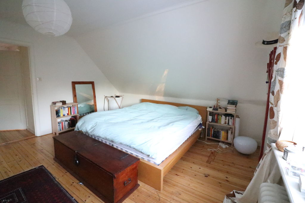 Main bedroom with wooden floors and wardrobes